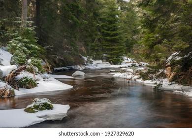 Svetla creek in winter snowy cold morning with sunshine color light - Shutterstock ID 1927329620