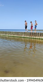 Svetlogorsk, Kaliningrad region, Russia - June 20 2021: The boys on the breakwater in the Baltic sea