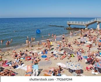 SVETLOGORSK, RUSSIA - AUGUST 23, 2009: People sunbathe on the beach