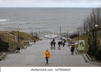 SVETLOGORSK, RUSSIA - MARCH 10, 2019: people on the promenade