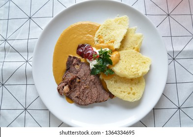 Svickova - Traditional czech dish: Marinated beef sirloin with creamy root vegetable sauce and bread dumplings