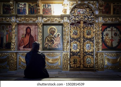 SVIYAZHSK, RUSSIA - AUGUST 20, 2019. Prist praying in the Assumption Cathedral of 16th century, located on the territory of Assumption male monastery. Town of Sviyazhsk, Republic of Tatarstan, Russia.