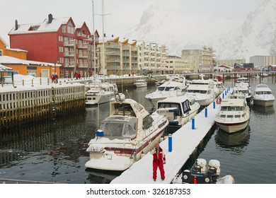 SVOLVAER, NORWAY - MARCH 26, 2011: Unidentified man stands at the harbor of Svolvaer, Norway. Svolvaer harbor is the starting point for held yearly in March International cod fishing competition.