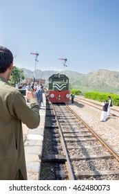 Swabi, PAKISTAN - Sept 27: Safari train coming bag travel to Peshawar from Attack and same Young man making video, on 27 Sept, 2015 Swabi