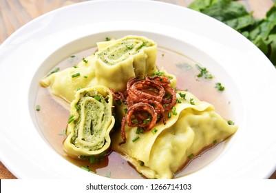 Swabian dumplings in broth (German name is Schwäbische Maultaschen in Brühe). South German Cuisine
