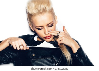 Swag girl in black leather jacket sniffing cocaine (imitation, flour). White background, not isolated