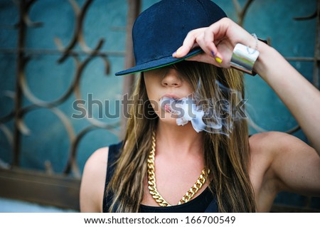 swag girl smoke coming out of her mouth in cap
