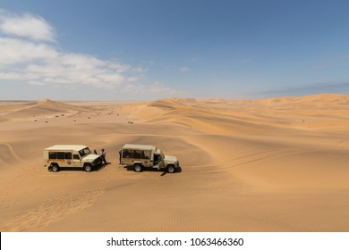 SWAKOPMUND, NAMIBIA – MARCH 03 2018: Vehicles of a guided desert tour on the Dunes near Swakopmund.