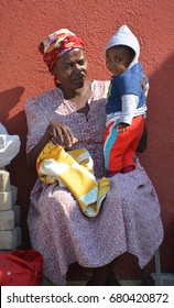 SWAKOPMUND, NAMIBIA OCTOBER 09, 2014: Unidentified mother and child living in Mondesa slum of Swakopmund on october 09 2014. In Namibia About 27.6 per cent of households are classified as poor.