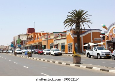 SWAKOPMUND, NAMIBIA - October 13. African shopping street with colorful colonial buildings, parked cars and traffic road on October 13, 2016 in Swakopmund. Along the Skeleton Coast.