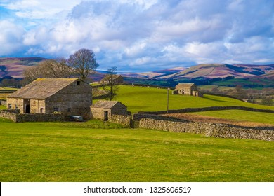 Swaledale, North Yorkshire. Swaledale is known for small stone wall surrounded fields with stone barns and Swaledale Sheep. Swaledale is part of the North Yorkshire dales.
