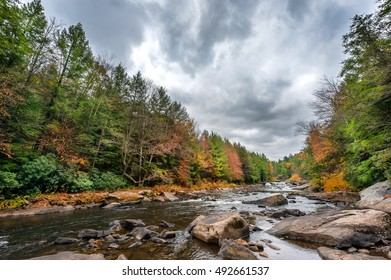 Swallow falls waterfall and river in the Appalachian mountains of Maryland during Autumn