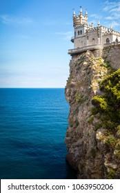 Swallow's Nest castle on a rock over the Black Sea, Crimea, Russia. It is a famous landmark and symbol of Crimea. Vertical scenic view of the Crimea castle in summer. Beautiful landscape of Crimea.