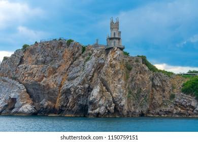 Swallows Nest castle on the rock over the Black Sea, Crimea, Yalta. landmark of Crimea, view from sea