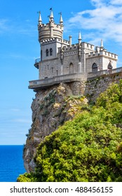 Swallow's Nest castle on a rock over the Black Sea in summer, Crimea, Russia. It is a symbol and landmark of Crimea. Amazing view of Swallow's Nest at the precipice. Traveling and vacation in Crimea.