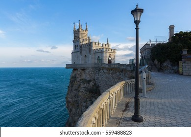 Swallow's Nest castle on the rock over the Black Sea on the sunset. Gaspra. Crimea
