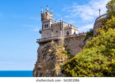 Swallow's Nest castle on the rock at Black Sea in summer, Crimea, Russia. It is a symbol and landmark of Crimea. Beautiful scenic view of Swallow's Nest at the precipice in the South coast of Crimea.
