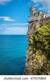 Swallow's Nest castle on the rock over the Black Sea in Crimea, Russia. It is a famous landmark of Crimea. Amazing scenic view of Swallow's Nest at the top of mount. Beautiful postcard of Crimea.