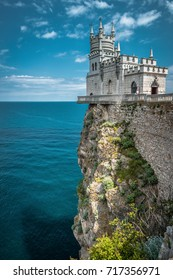 Swallow's Nest castle on a rock over the Black Sea, Crimea, Russia. This castle is a landmark and symbol of Crimea. Beautiful castle at the top of steep shore. Amazing view of the castle on a cliff.