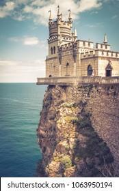 Swallow's Nest castle over the Black Sea, Crimea, Russia. Landmark of Crimea in summer. Amazing view of the castle on a rock. Swallow's Nest is a symbol of Crimea. The vintage style photo of Crimea.