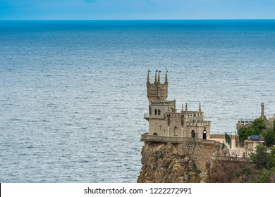 Swallow's Nest on the edge of a cliff against the background of the sea, view of the landmark of the Crimea - Russia