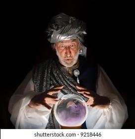 Swami gazing into a crystal ball