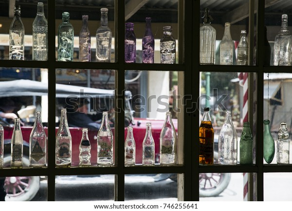 SWAN HILL, VICTORIA, AUSTRALIA : 26 OCTOBER 2017 - Antique bottle collection in a window display at the Swan Hill Pioneer Settlement in North West Victoria.