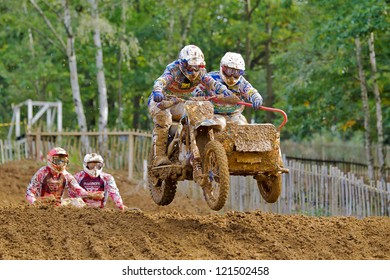 SWANLEY, UK - OCTOBER 7: Richard Jenkins & Dan Chamberlain take the second jump in a two stage step down during the ACU British sidecar Nationals MX at Canada Heights on October 7, 2012 in Swanley