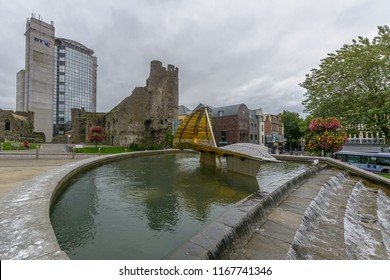Swansea, UK - Aug 27, 2018: Castle Square - Fountain and Castle Ruins