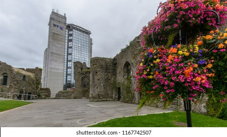 Swansea, UK - Aug 27, 2018: Swansea Castle with Flowers and BT building in background