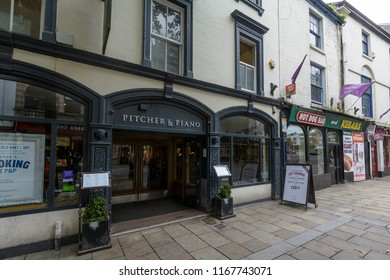 Swansea, UK - Aug 27, 2018: Pitcher and Piano Entrance, 59-60 Wind Street Swansea, Modern chain bar serving beer, wine and cocktails, plus a menu of grazing plates and pub classics