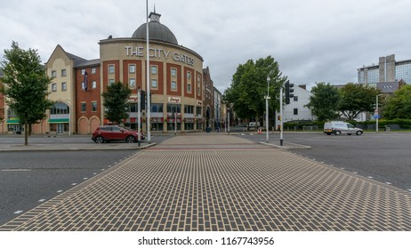 Swansea, UK - Aug 27, 2018: Unique Zebra Crossing and The City Gates