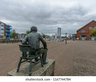 Swansea, UK - Aug 27, 2018: Rear View of Dylan Thomas Statue on Marina Market Swansea