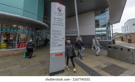 Swansea, UK - Aug 27, 2018: Swansea City Bus Station - Entrance, Focus on Information Board, Shallow Depth of Field