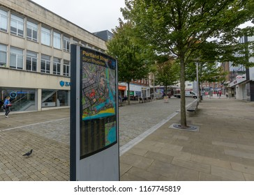 Swansea, UK - Aug 27, 2018: Looking Down Portland Street Swansea, Focus on Information Board, Shallow Depth of Field