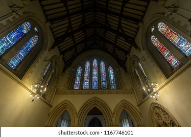 Swansea, UK - Aug 27, 2018: St Mary Church Chancel looking up Stained Glasses