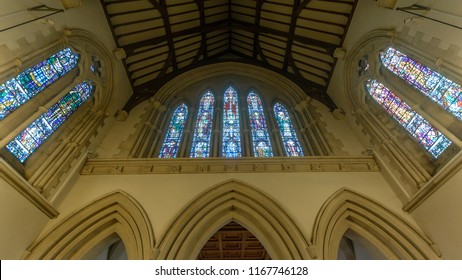 Swansea, UK - Aug 27, 2018: St Mary Church Stained Glasses above High Altar
