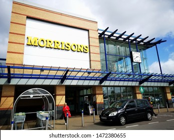 Swansea, UK: August, 2019: Main entrance to a Morrisons superstore. Morrisons is the fourth largest chain of supermarkets in the United Kingdom.