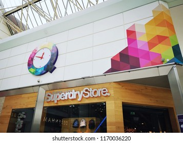 Swansea, UK: August 27, 2018: Street view of a Superdry Store. Superdry plc is a UK branded clothing company whose products combine vintage Americana styling with Japanese inspired graphics.