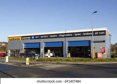 swansea, UK: December, 2016: Halfords Group plc is a British retailer of car parts, car enhancement, camping and touring equipment and bicycles. They also provide MOT, service and repairs