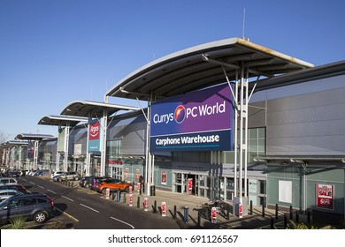 Swansea, UK: December 28, 2016: Currys and PC World Store incorporating a Carphone Warehouse. Building exterior of a computer hardware store.