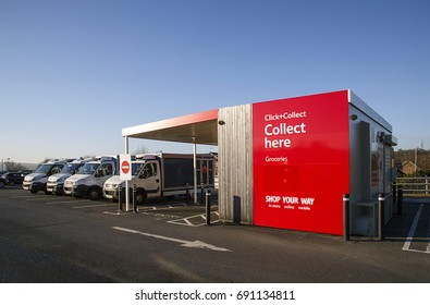 Swansea, UK: December 28, 2016: Tesco Click and Collect, order shopping online and collect from a local store for free. Delivery vans are parked alongside.