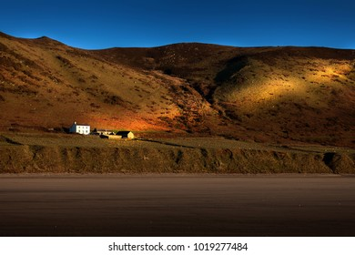 Swansea, UK - February 4, 2018: Probably the most photographed house in Wales, situated shore-side on one of Wales's best surfing beaches between the villages of Rhossili and Llangennith