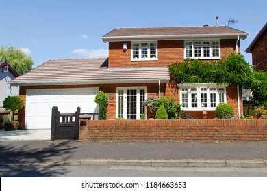 Swansea, UK: July 07, 2018: Four bedroom detached house on a housing estate. Typical 1980's design with attached garage and front garden.
