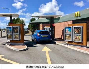 Swansea, UK: July 31, 2018: McDonalds Restaurant and Drive Through. McDonald's is the world's largest chain of hamburger fast food restaurants.