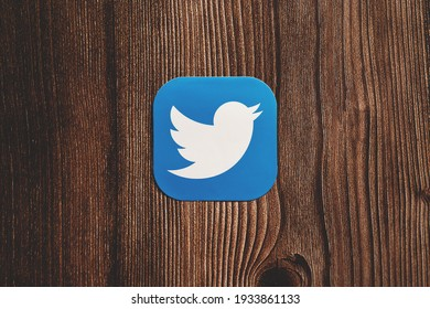 SWANSEA, UK - MARCH 11, 2021: Twitter app blue logo with bird printed on paper centrally placed on wooden background