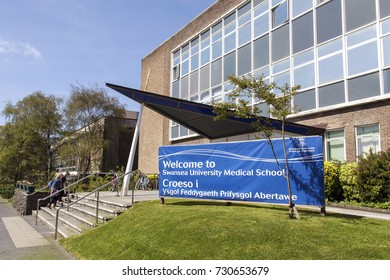 Swansea, UK: May 04, 2016: Students enter the main entrance to the Medical School building at Swansea University Singleton Campus.
