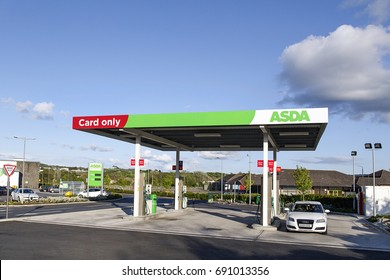 Swansea, UK: May 22, 2016: A self-service petrol station at an Asda supermarket. Asda Stores Limited is an American-owned, British-founded supermarket retailer, headquartered in Leeds, West Yorkshire.