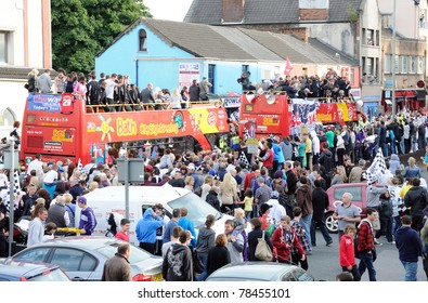 SWANSEA, UK - MAY 31: Huge crowds gather in Swansea city centre to watch The Swans' victory parade, after their promotion to Premier League football on May 31, 2011 in Swansea, UK.