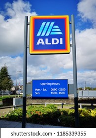 Swansea, UK: September 21, 2018: Commercial sign of ALDI Store against a blue sky with white cloud. ALDI is the common brand of two German discount supermarket chains with over 10,000 stores worldwide